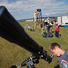 Record-Eagle/Keith King<br /> Hunter Sutton, 12, of Mesick, looks at sun spots through a filtered telescope as members of the Grand Traverse Astronomical Society set up other telescopes at the Open Space Tuesday. The group was on hand to celebrate its 30th anniversary, as well as to view the transit of Venus across the sun.