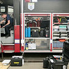 Record-Eagle/Jan-Michael Stump<br /> Traverse City fire fighter/paramedic Keith Fritz goes over equipment in the department's hazmat truck during a training at Station 1 on Wednesday evening.