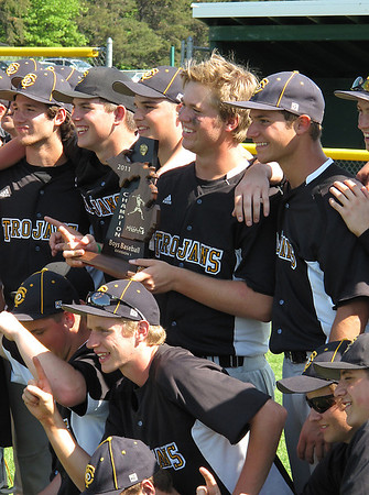 Record-Eagle/Mike Eckert<br /> Traverse City Central players pose with the Division 1 district trophy.