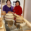 Record-Eagle/Loraine Anderson<br /> Cindy Patek, left, and Doris Winslow show off black ash split baskets made by Noah Jacko. The largest is on display at Eyaawing Museum in Peshawbestown.