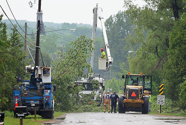 Record-Eagle/Keith King<br /> Workers repair storm damage along County Road 633 in Suttons Bay.