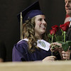 Record-Eagle/Keith King<br /> Danielle Bott is congratulated and handed a rose Sunday, June 5, 2011 during the Traverse City St. Francis High School graduation ceremony.