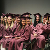 Record-Eagle/Keith King<br /> Traverse City High School graduating seniors laugh as they sit on stage Friday during their graduation ceremony in Milliken Auditorium at the Dennos Museum Center.