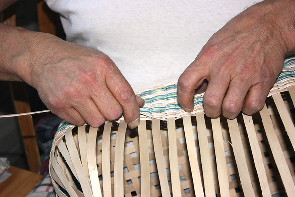 Record-Eagle/Loraine Anderson<br /> A close-up view shows how basket maker Frank Weese tightly weaves a black ash strip through a larger split, also black ash.