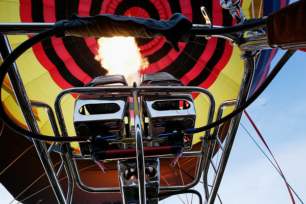 Record-Eagle file photo<br /> A pilot uses a burner to inflate a balloon.