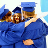 Record-Eagle/Jan-Michael Stump<br /> A group of Traverse City College Preparatory Academy seniors hug before the start of Friday's graduation.