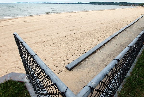"""Record-Eagle/Jan-Michael Stump<br /> Traverse City State Park will be installing a """"Mobi-Mat,"""" a stationary, 60-inch wide fabric that creates a portable sidewalk on the sand to increase accessibility for visitors."""