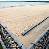 "Record-Eagle/Jan-Michael Stump<br /> Traverse City State Park will be installing a ""Mobi-Mat,"" a stationary, 60-inch wide fabric that creates a portable sidewalk on the sand to increase accessibility for visitors."