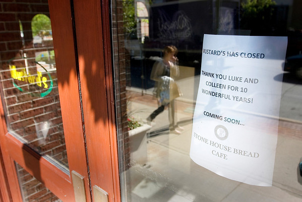 Record-Eagle/ Keith King<br /> A piece of paper on the door of Mustard's Monday announces the restaurants closing. Stone House Bread is expected to open soon in the location.