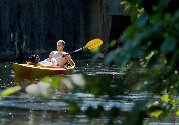 Record-Eagle/ Keith King<br /> Mike Nepote, of Traverse City, kayaks down the Boardman River with his dog Jake on Monday.