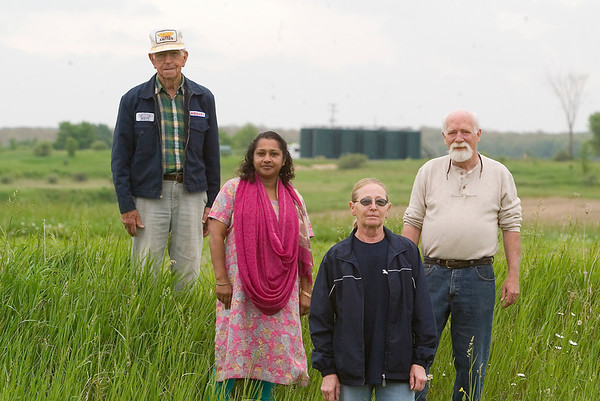 Record-Eagle/Jan-Michael Stump<br /> From left, neighbors Ray Weber, Angela Dhami, Margaret Deater and township planning official Phil Scott oppose the proposed re-classification of a well in Mayfield Township.