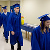 Record-Eagle/ Keith King<br /> Graduating seniors walk to their seats before the ceremony.