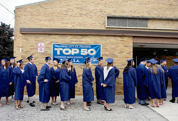 Record-Eagle/ Keith King<br /> Students line up outside of the Traverse City St. Francis High School gymnasium Sunday before the start of the St. Francis High School graduation ceremony.