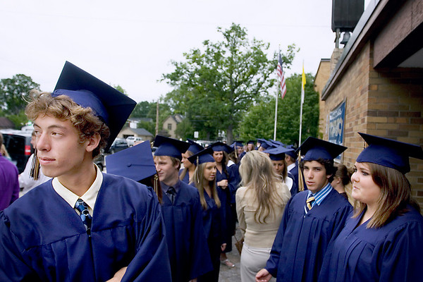 "Record-Eagle/ Keith King<br /> From left, James Alpers, 18, Roger Belanger, 18 and Liza Armour, 17, all of Traverse City, wait outside of the gymnasium prior to the start of the St. Francis High School graduation ceremony. ""Is anyone here as nervous as I am?"" Belanger said."
