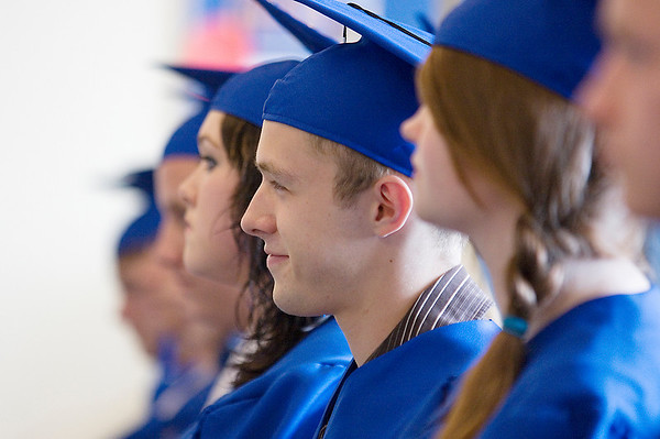 Record-Eagle/ Keith King<br /> Walter Hoover, 18, of Traverse City, listens to classmate Frank O'Brien (not pictured) during the Traverse City College Preparatory Academy graduation ceremony.