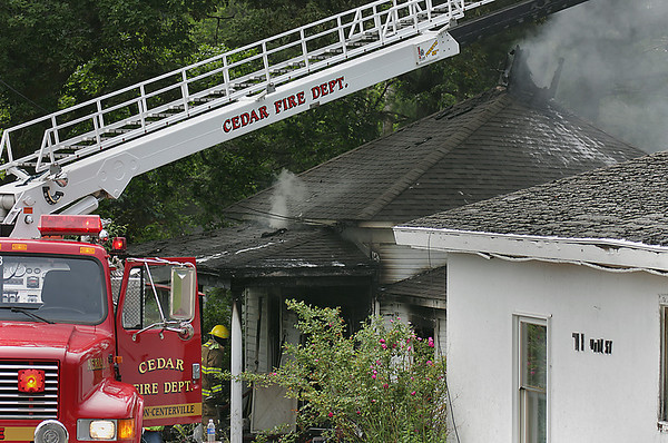 Record-Eagle/ Keith King<br /> Emergency personnel respond to a house fire Friday in Maple City.