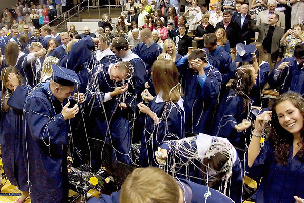 Record-Eagle/ Keith King<br /> Traverse City St. Francis High School graduates clean silly string off themselves. The silly string was sprayed once they were announced as the Class of 2010.