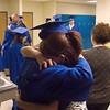 "Record-Eagle/ Keith King<br /> Brandi Stewart, right, 16, of Traverse City, hugs Ashley Montgomery, 18, of Traverse City, on Wednesday at the conclusion of the Traverse City College Preparatory Academy graduation ceremony. ""She's like a sister to me,"" Brandi said."