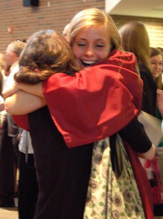 Record-Eagle/Sarah Brower<br /> Kelley Ritsema hugs a friend following Traverse City Christian High School's graduation ceremony.
