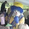 Record-Eagle/Lisa Perkins<br /> Mineau the Clown delights the crowd during the 22nd Annual National Cancer Survivors' Day celebration picnic, held Sunday, on the lawn of Building 50 in Traverse City.