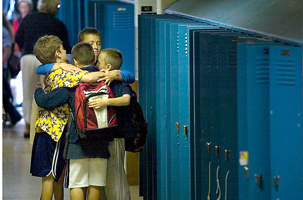 Record-Eagle/Jan-Michael Stump<br /> From left, fourth-graders Seve Colangelo, Darryl Carlisle, Grant Lesoski and Liam Simon share a hug in the hallway of Eastern Elementary on their last day of school.