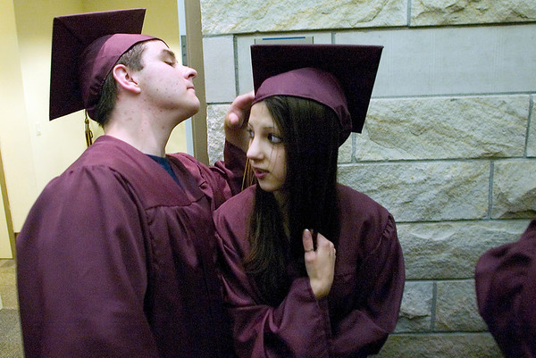 Record-Eagle/Jan-Michael Stump<br /> Michael Taylor, left, and Sara Boomer wait outside Milliken Auditorium for the start of Traverse City High School graduation.