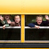 Record-Eagle/Jan-Michael Stump<br /> Eastern Elementary students wave to classmates as their bus pulls away.
