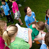 Record-Eagle/Jan-Michael Stump<br /> Fifth-grade students at Eastern Elementary sign each other's yearbooks and T-shirts during a class picnic outside on their last day of school.