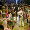 Record-Eagle/Jan-Michael Stump<br /> Eastern Elementary students walk through hallways lined with other students, staff and parents on the last day of class, a school tradition.