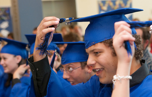 Record-Eagle/Douglas Tesner<br /> Benaiah VanDyken and other students turn their tassels at the end of their Commencement Ceremony at Traverse City College Preparatory Academy. This year the school had a total of 14 graduating seniors.