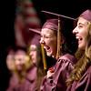 Record-Eagle/Jan-Michael Stump<br /> Traverse City High School seniors Andrea Dixson, left, and Brooklyn Waterman laugh during graduation at Milliken Auditorium.