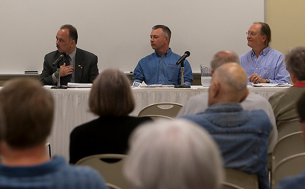 Record-Eagle/Douglas Tesner<br /> Panelists at the newspaper forum included Mike Casuscelli, publisher of the Record-Eagle; Alan Campbell, publisher of the Leelanau Enterprise; and Robert Downes, chief editor and co-publisher of the Northern Express.