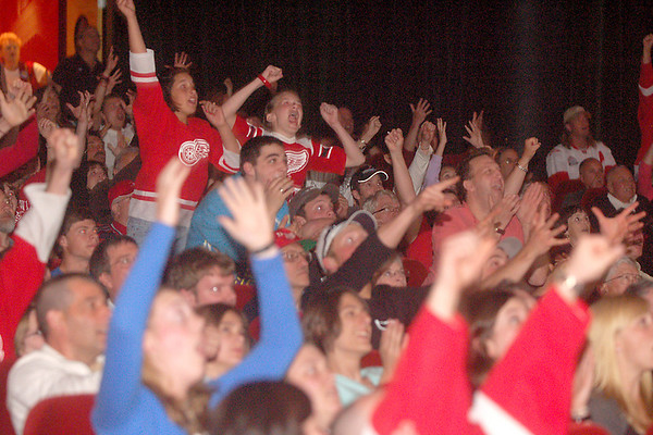 Record-Eagle/Sarah Brower<br /> The crowd at the State Theatre cheers when Jonathan Ericsson scored the Red Wings first and only goal in the third period of Game 7 against the Pittsburgh Penguins on Friday night.