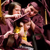 Record-Eagle/Jan-Michael Stump<br /> Michael Taylor puts a mortar board on his son Trenton, 18 months, after he and girlfriend Sara Boomer received their diplomas at TC High School's graduation.