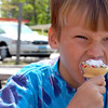 Record-Eagle/Sarah Brower<br /> Jon Drettmann, 6, of Traverse City, takes a big bite of ice cream at  Bardon's Wonder Freeze.