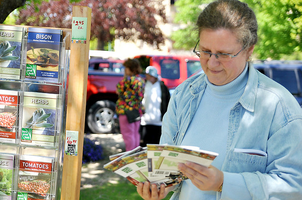 Record-Eagle/Vanessa McCray<br /> Learn Great Foods president Ann Dougherty flips through booklets with recipes and food tips offered for sale at the farm market at The Village at Grand Traverse Commons.