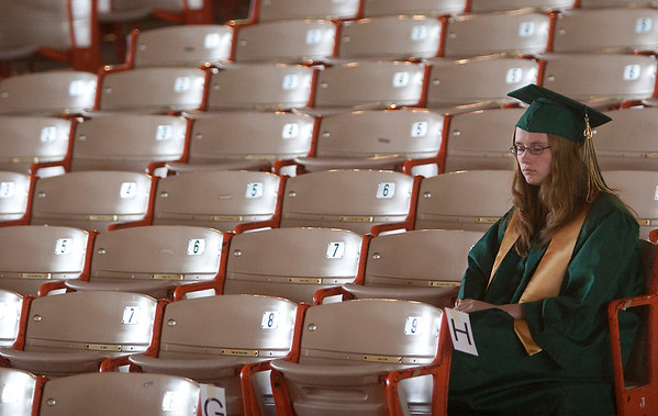Record-Eagle/Douglas Tesner<br /> Michelle Harrington sits in solitude before Traverse City West Senior High School's commencement ceremony at Kresge Auditorium on the Campus of the Interlochen Center for the Arts. It was a bittersweet experience, she said.
