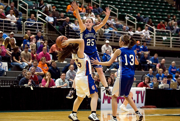 Record-Eagle/Jan-Michael Stump<br /> Central Lake's Sheila Crouse (33) looks for an outlet past Adrian Lenawee Christian's Tenille Marowelli (25) and Brooklyn Wingfield (13) in the state Class D semifinals Thursday at the Breslin Student Events Center in East Lansing.