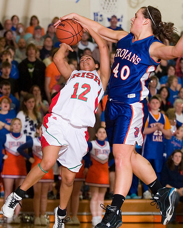 Record-Eagle/Jan-Michael Stump<br /> Central Lake's Jasmine Hines (40) blocks a shot by Mt. Pleasant Sacred Heart's Amitra Pawer (12) in Tuesday's state quarterfinal game at Benzie Central High School.