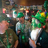 Record-Eagle/Jan-Michael Stump<br /> From left, Kevin Parks, Al Clark  and Bill Nixon celebrate St. Patrick's Day in a packed Union Street Station in downtown Traverse City on Wednesday afternoon.