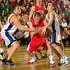 Record-Eagle/Jan-Michael Stump<br /> Suttons Bay's Noah Reyhl (23) fights for a rebound with Mason County Central's Brandon Melchert (34) and David Soraci (11) in Wednesday's regional final.
