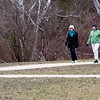 Record-Eagle/Douglas Tesner<br /> Sandy Fritz and Margy Klesney are escorted through Medalie Park by several geese as they walk the Boardman Lake Trail.