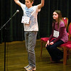 Record-Eagle/Jan-Michael Stump<br /> Austin Wolfgram reacts after winning the Grand Traverse Regional Spelling Bee as runner-up Nicole Blakken-Esser watches Sunday at the City Opera House.