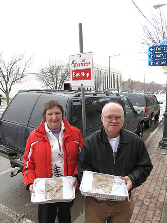 Valma Davis, left, bakes up cookies regularly for BATA bus system employees in appreciation for their work. Her husband Dean, right, delivers the treats.