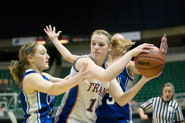 Record-Eagle/Jan-Michael Stump<br /> Central Lake's Jennifer Corbett (13) gets trapped by Adrian Lenawee Christian's LeAnn Porter (15) and Brooklyn Wingfield (13) in the state Class D semifinals Thursday at the Breslin Student Events Center in East Lansing.