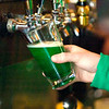 Record-Eagle photo/Jan-Michael Stump<br /> Green beer is poured at Union Street Station in Traverse City last year on St. Patrick's Day.