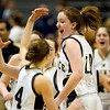 Record-Eagle/Jan-Michael Stump<br /> St. Ignace players Nicole Elmblad (4) and Katy LaTour (10) celebrate their 65-34 win over Niles Brandywine in the state Class C semifinals Thursday at the Breslin Student Events Center in East Lansing.