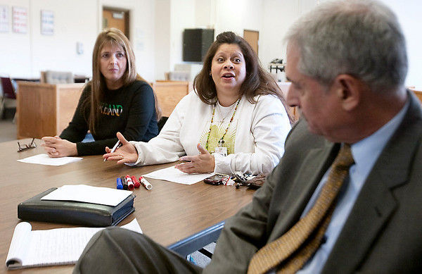 Record-Eagle/Douglas Tesner<br /> Teachers Mary McGee-Cullen, and Florina Kapitzke talk with Michael Wilmot of Michigan Leadership Institute about what they want in a new superintendent.