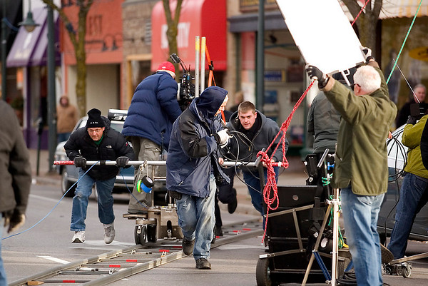 "Record-Eagle/Jan-Michael Stump<br /> Crews push a camera on a dolley to film a scene with actor Josh Lucas for ""A Year in Mooring,"" on East Front Street in Traverse City."