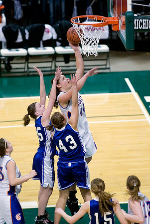 Record-Eagle/Jan-Michael Stump<br /> Central Lake's Jasmine Hines (40) scores over Adrian Lenawee Christian's Tenille Marowelli (25) and Andrea Sebby (43) in the state Class D semifinals Thursday at the Breslin Student Events Center in East Lansing.